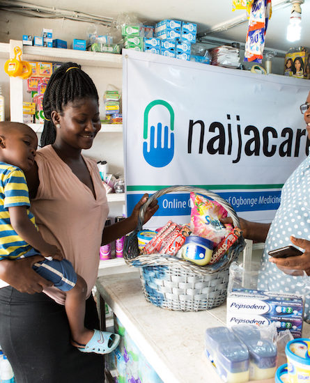 Woman buying from a NaijaCare PPMV